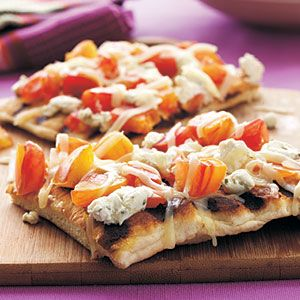 Grilled Heirloom Tomato and Goat Cheese Pizza by myrecipes #Pizza #Tomato #Goat_Cheese #myrecipes