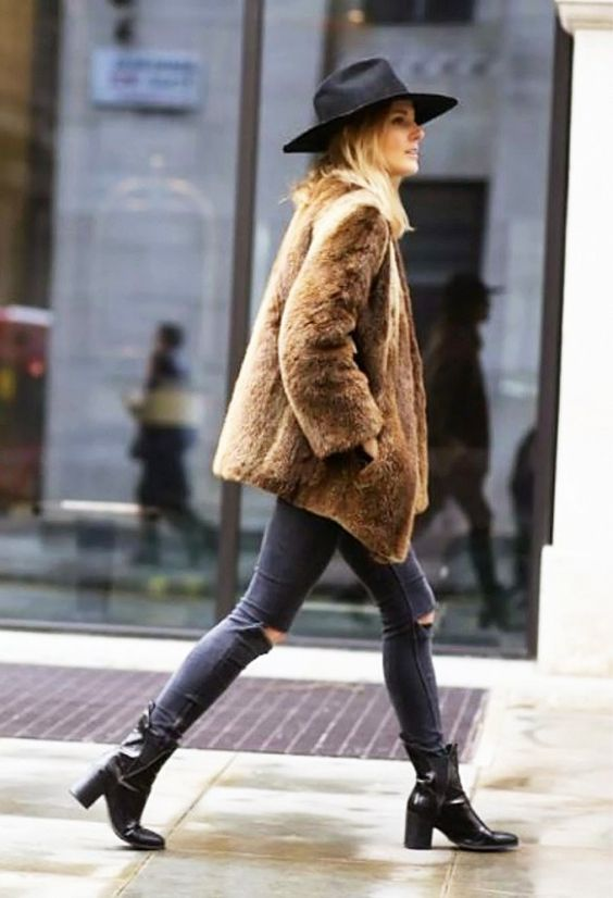 Black wide brim hat, brown fur jacket, ripped skinny jeans, and black tall ankle boots: