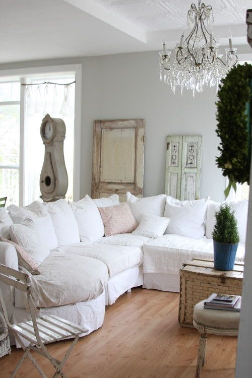 Worn Painted Furniture And Faded Chintz Curtains And Fabrics Evoke The Aura Of Old World Vintage Co Shabby Chic Living Room Shabby Chic Living Chic Living Room #shabby #chic #living #room #curtains