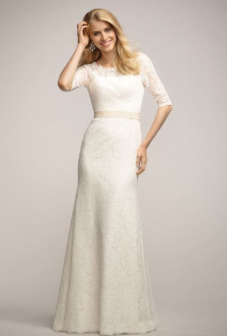 Lace dress with bateau neck, keyhole back and 3/4 length sleeves with slim a-line floor length skirt.  Grosgrain ribbon at waist.