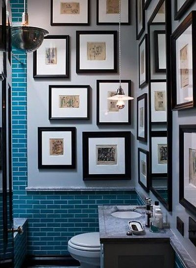 Steven Gambrel has used small scale prints to decorate a bath. Colored tile frames the installation.