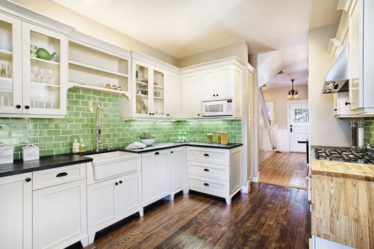 I love this kitchen, except for the wood on the right (blech). But black counter top, white cabinets, dark wood floors (although I don't love the multiple tones) and the green back splash AND a farmhouse sink! Love!