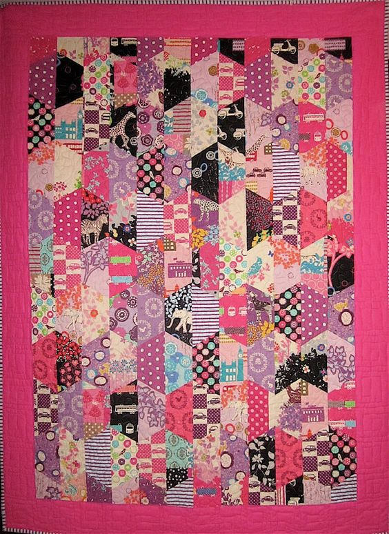 ::Pink and black Echino Hexcentric throw quilt:: I'm a longtime fan of half-hexagon units, love this layout that emphasizes the vertical striping with the hex-angles fading in and out according to low- vs. high-contrasting prints.