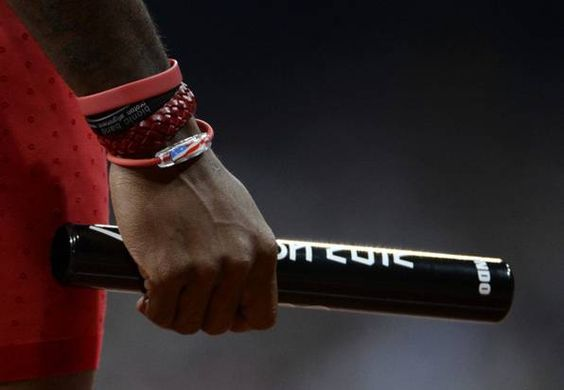USA's Trell Kimmons---- grips the ''baton'' before the start of the 4x100 meter relay final at Olympic Stadium during the London 2012 Olympics, August, 2012