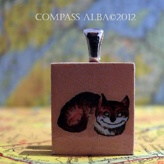 Scabble tile pendant off the chesser cat,
