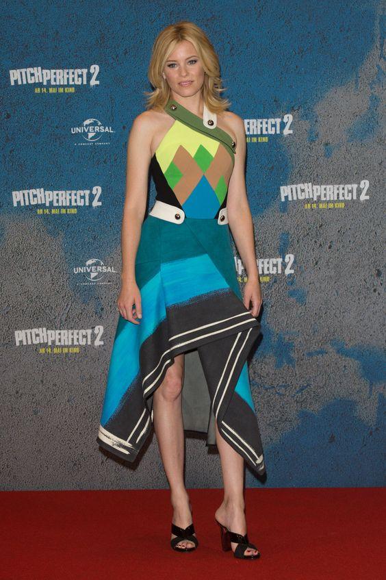 She wears a high-octane, geometric asymmetrical frock at the Berlin premiere.   - MarieClaire.com