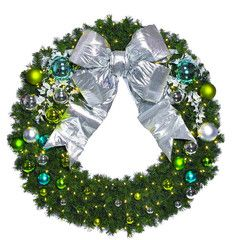 Coastal Wreath decorated in shiny and matte apple green, turquoise and silver ornaments with silver ivy and a silver bow.  Lit with warm white LED mini lights.