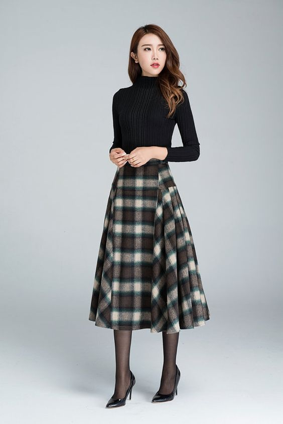 DETAILS: * grid wool skirt * polyester lining * fitted waist * back zipper *pleated two sides MODEL SIZE: bust:85 cm(33.4) waist:64 cm height:168 cm SIZE GUIDE Available in women's US sizes 2 to 18, as well as custom size and plus size. Size chart PDF https://img1.etsystatic.com/117/0/7768512/icm_fullxfull.88761713_kppuw4pg028c0wso0ckk.pdf PHOTO https://img0.etsystatic.com/106/0/7768512/icm_fullxfull.84716330_lak6w7e7t5cc0kcows44.jpg NOTE When you place an order, would you Please leave...