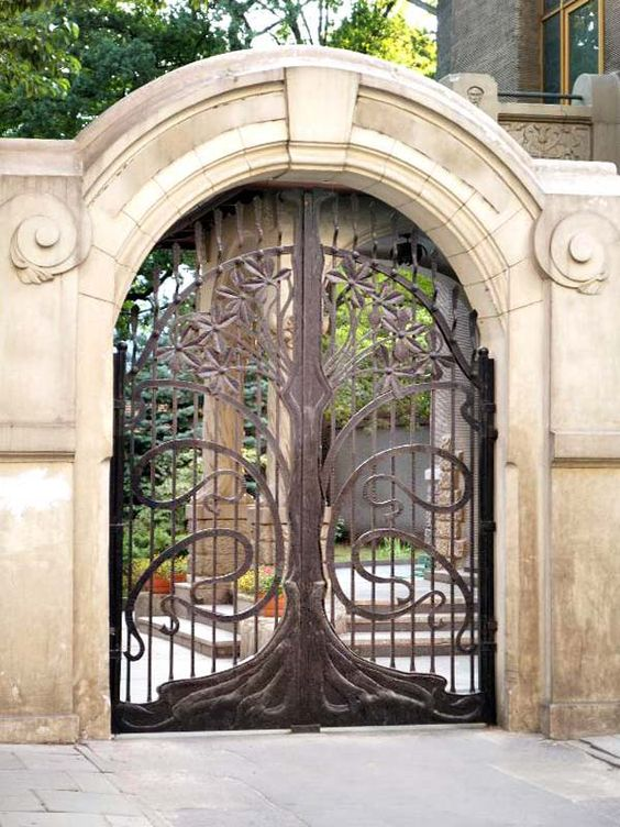 I love the tree motif of this gate gate design from for Iron garden gate designs
