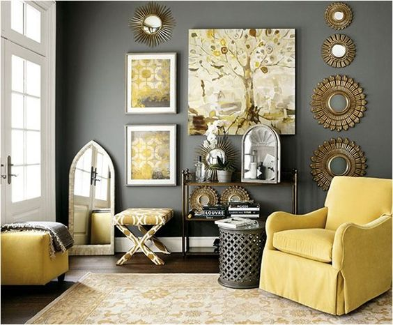 Area rugs are yet another tool for deciding what colors or patterns to include in a space, yellow and gray dominating the motif of the rug in this living room, and the same hues reappearing in the fabrics, artwork, and wall color.: