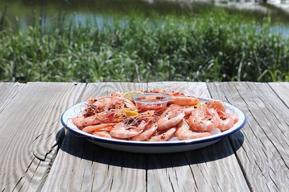 I bought one in NOLA @ the Oyster Fest - love it!  The pics really don't do it justice.  Vintage Enamel Serving Tray Shrimp Serving by whitemarshislandwood
