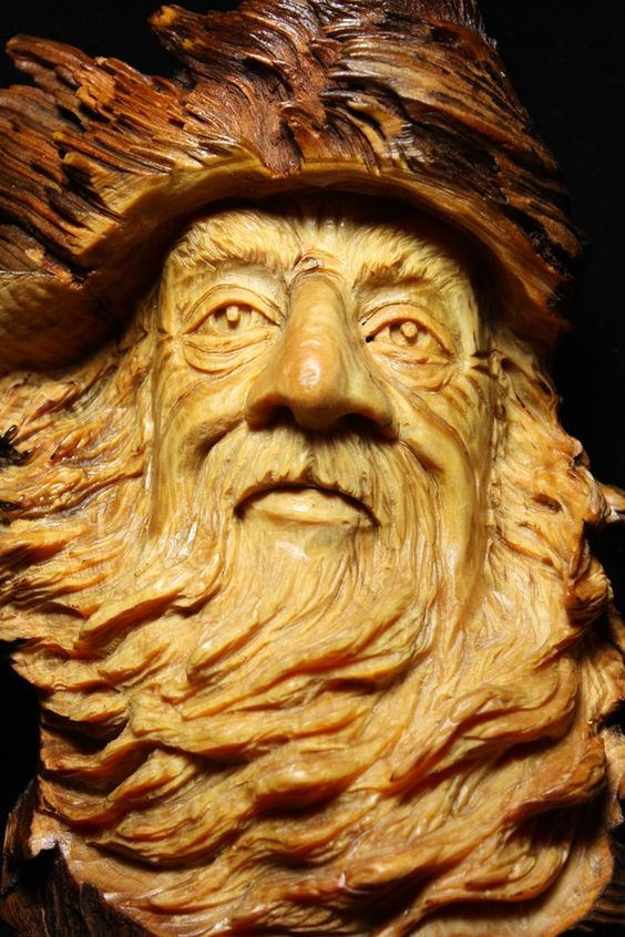 Fizban the wood spirit elf wizard carved in a pine knot