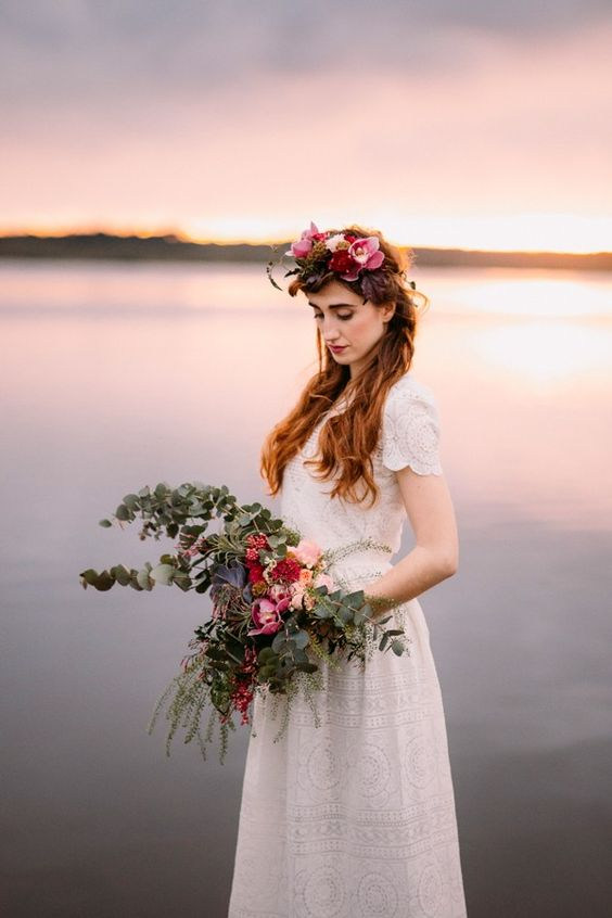 Beautiful bright blooms, lush greenery, and a lace dress has this bride exuding romantic, bohemian vibes| Image by  Forester Fotógrafos