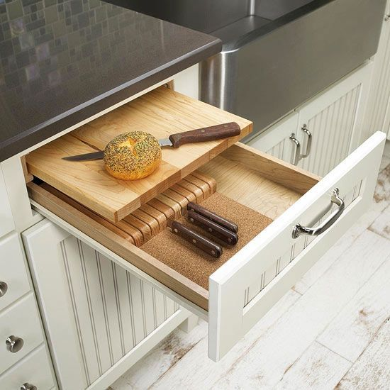 This knife storage drawer has slots to hold knives and a built in cutting board. Find more storage solutions: www.bhg.com/...:
