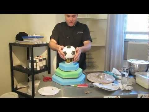 """Tony """"The Pastryarch"""" Fondant Soccer Cake Decorating Tutorial/Demo & Techniques Video - This is my first cake decorating tutorial (and also my first time editing together a video). Watch me create a 4 tiered soccer ball/themed Birthday cake! Throughout the video I demo certain techniques, give tips & guide you through the process of making a """"wow"""" cake. Enjoy and look for more videos soon that'll be more fun & exciting! Find me @ www.facebook.com/thepastryarch and…"""