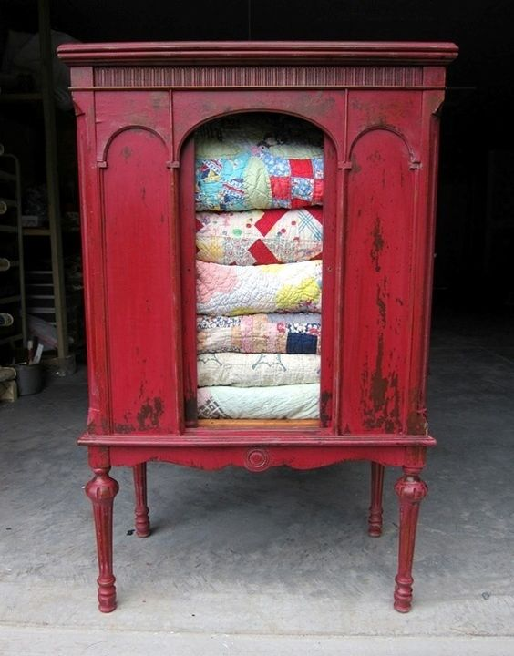 China Cabinet Quilt Storage.  Great Idea!!:
