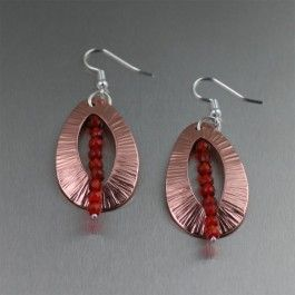 Be the Belle of the Ball when you make your grand entrance wearing these stunning Chased #Copper Tear Drop #Earrings with faceted #Carnelian gemstones. The unforgettable contemporary design gives a look that's simply magical. $65