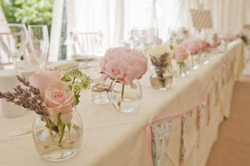 The top table was decorated with small glasses of baby pink blooms. Image: Melissa Elsey, Looking Glass Photography