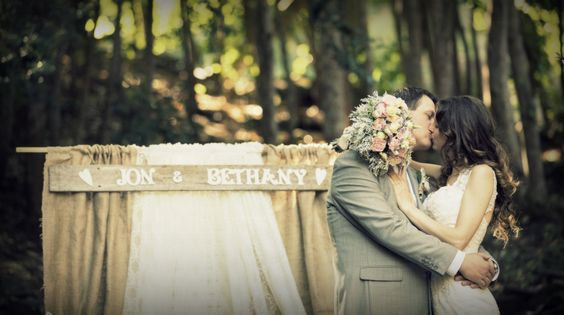 kissing shot in front of our rustic hessian and lace backdrop @ the Fairy Dell, Cataract Gorge