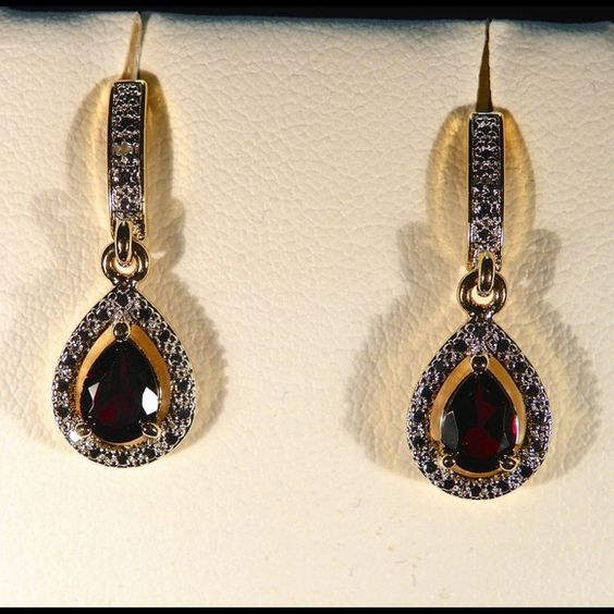 Garnet and Diamond studs. 14k Yellow Gold and Rhodium plated Brass Stud Earrings decorated with Garnet and White Diamonds. One of my favorite Earrings. Jewelry Earrings