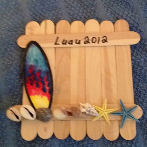 Jumbo craft stick photo frame    An easy craft idea that all ages can do and have fun making! Cub Scout Day Camp theme is Luau this year!  Supplies need: Starfish, Seashells, 9 jumbo craft sticks, 3 regular craft sticks and a surfboard ornament. Additional supplies a black marker and a low temp glue gun