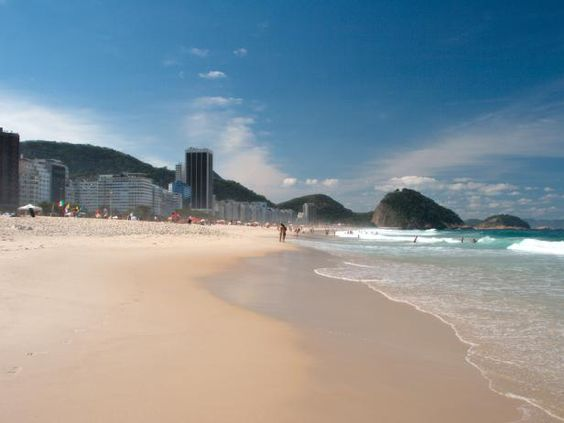 Copacabana, often referred to as the world's most famous beach, runs for 3 miles in front of the densely populated residential area of Rio de Janeiro.