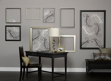 Benjamin Moore Wall Tattoo:  Notes of whimsical design play across a long open space in perfect harmony with surrounding furnishings.    We've grouped frames that share a similar style and tone to create a focal point for the large wall. Some of the frames are blank, while others envelop delicate tattoos of rich purple and sparkling silver to create a look that is balanced, yet not overwhelming.