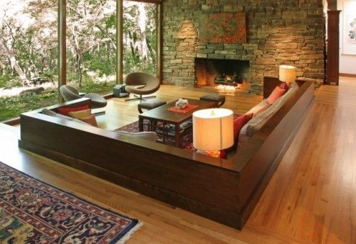 Built in couch! Love the wood & stone & glass. I'd add bookcases around the back .
