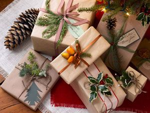 Use plain brown paper and embellish with things you already have.