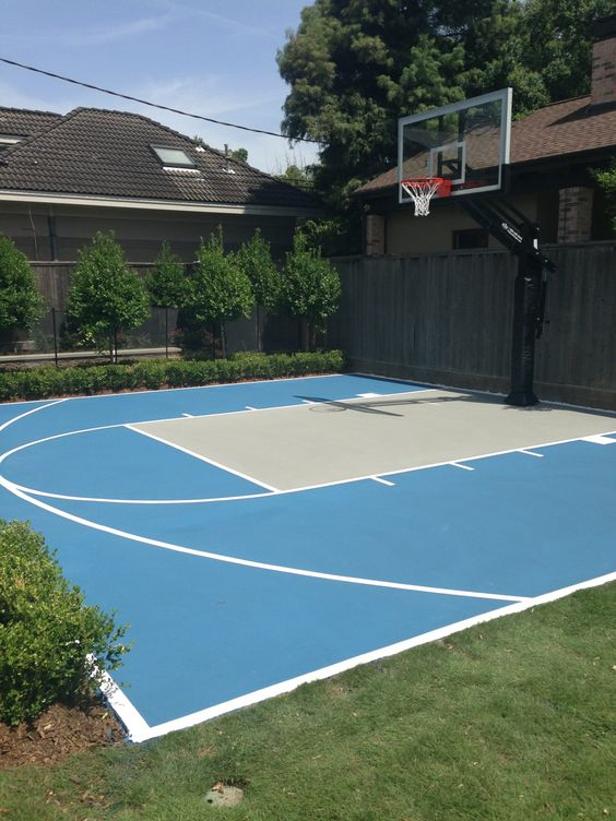 This pro dunk platinum basketball goal sits over a painted for Building a half court basketball court