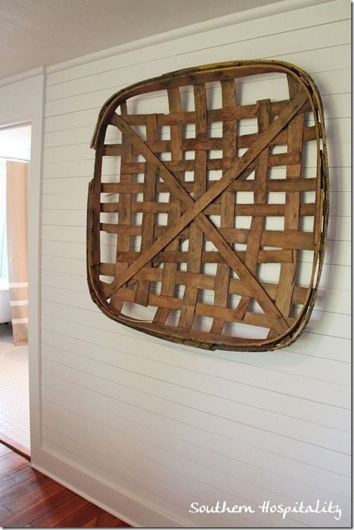 Tobacco basket on wall - trend. From Southern Living idea house via Southern Hospitality blog.