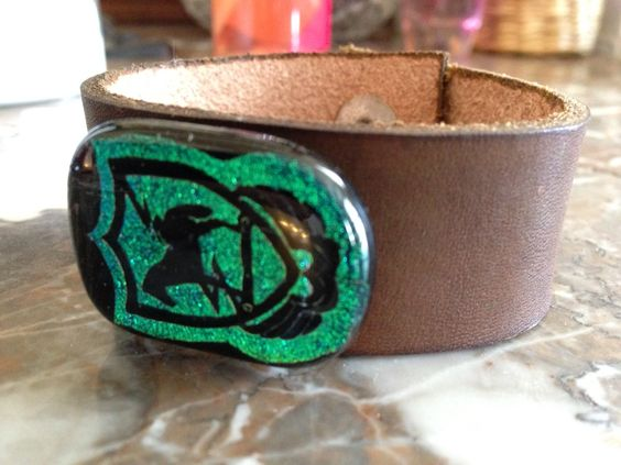 Custommade.com for $35, send in your unit crest or logo and pick your color glass and leather. Seller Mary Kim Hanson.  She does pendants, bracelets and a host of other things too.