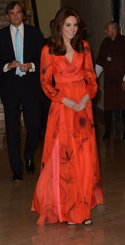April 15th: For their final evening in Bhutan, Kate wore British designer Beulah, founded by her friend Natasha Rufus Isaacs. The red silk dress from the brand's SS15 collection was adorned with a beautiful poppy print, the national flower of Bhutan.: