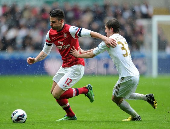 Giroud receives the attention of Davies... #Swansea v #Arsenal