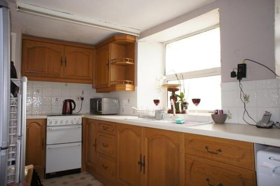 Nice size Kitchen, ground level. Door to out door alley leading to main street. Kitchen also has a door that leads to the lounge. Small airing Cupboard situated in Kitchen. Stairs go down from Kitchen area to bedroom.
