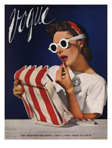 It's July and all remains red, white and blue. The July 1939 Vogue cover by Horst P. Horst (at Art.com):