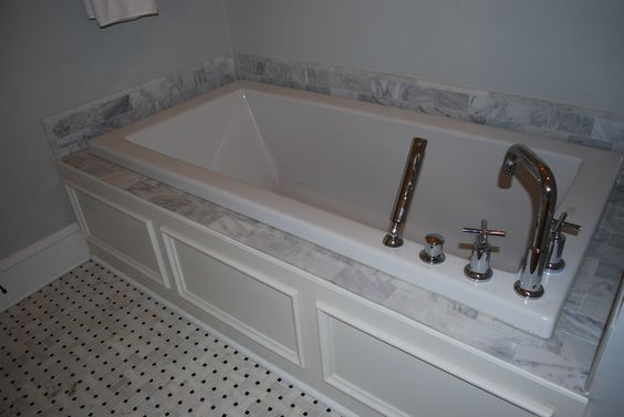 Soaking tubs carrara marble and marble tiles on pinterest for Deep built in bathtubs