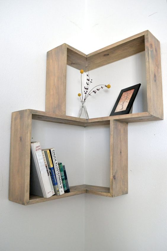 Corner box shelf. This would take up way less space than a bulky bookshelf! Staircase shelves?: