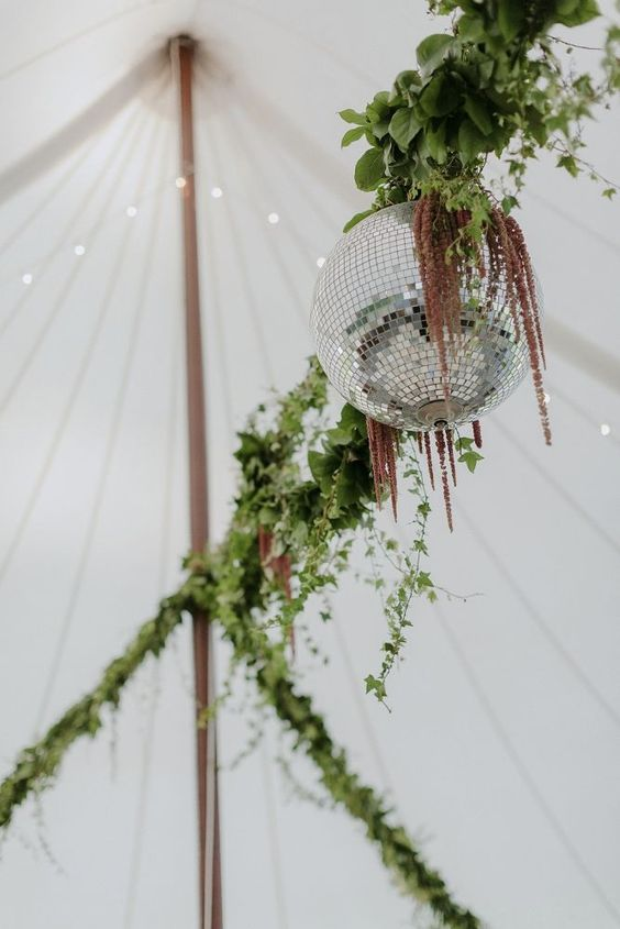 The vintage disco ball on our dance floor set the tone for the partying to come. - Over The Moon