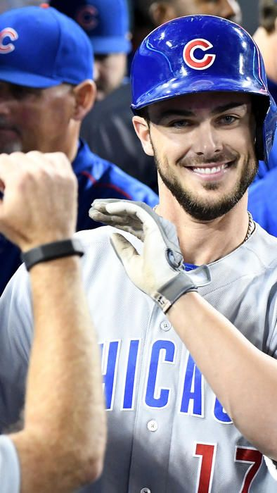 Kris Bryant is greeted in the dugout after a solo home run in the eighth inning Friday, Aug. 26, 2016, in Los Angeles. (Jayne Kamin-Oncea / Getty Images)
