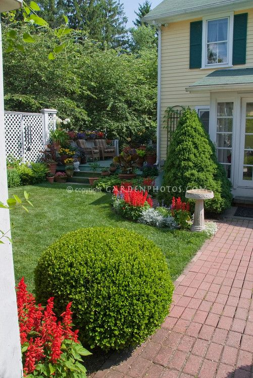 Home Landscaping With Brick Pathway Annual Flowers