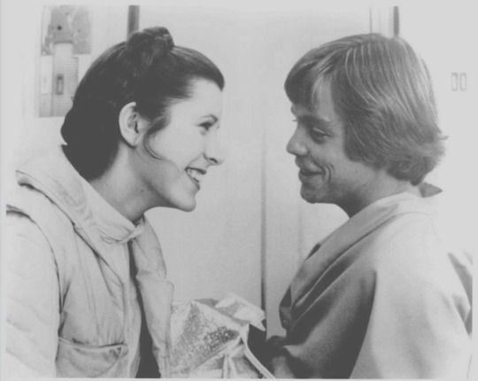 Retro Star Wars Strikes Back Carrie Fisher and Mark Hamill sharing a joke on the set of Empire Strikes Back-