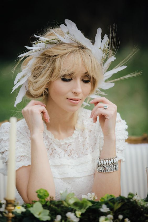 Be the center of attention with this hair style - feathers on hair.