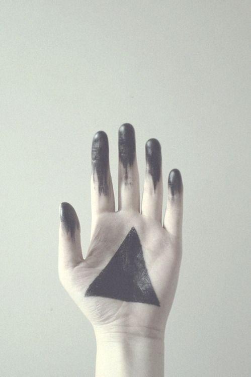 // hand // black triangle //