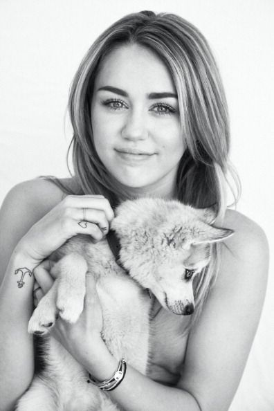 miley with a puppy makes me want to like miley...