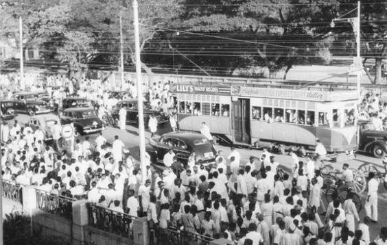 Crowds outside The Hindu's office in 1949 follow the scores of a cricket test match. In the background in the middle of the road, is a tram, a popular means of transport in the city since 1895. Trams were withdrawn in 1953 and the rails removed in 1957-58, ending once and for all hopes of trams running again in Madras.