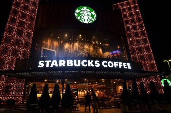 SBUX Vietnam first store at night. Logo is like a beacon and metal panels light up at night.
