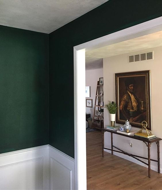 Finally got around to giving my dining room the drama it needed! Loving the color. 💚 (this was after the first coat) Benjamin Moore - Hunter Green (lightened 25%):