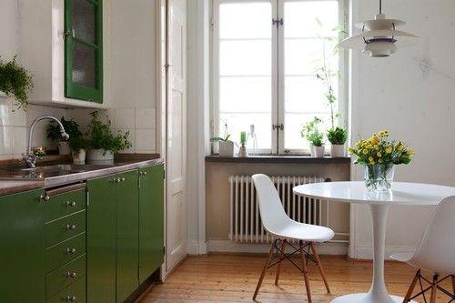 wooden floor & green kitchen