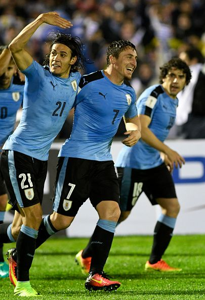 #WCQ2018 Edinson Cavani of Uruguay celebrates with teammate Cristian Rodriguez after scoring the second goal during a match between Uruguay and Paraguay as...
